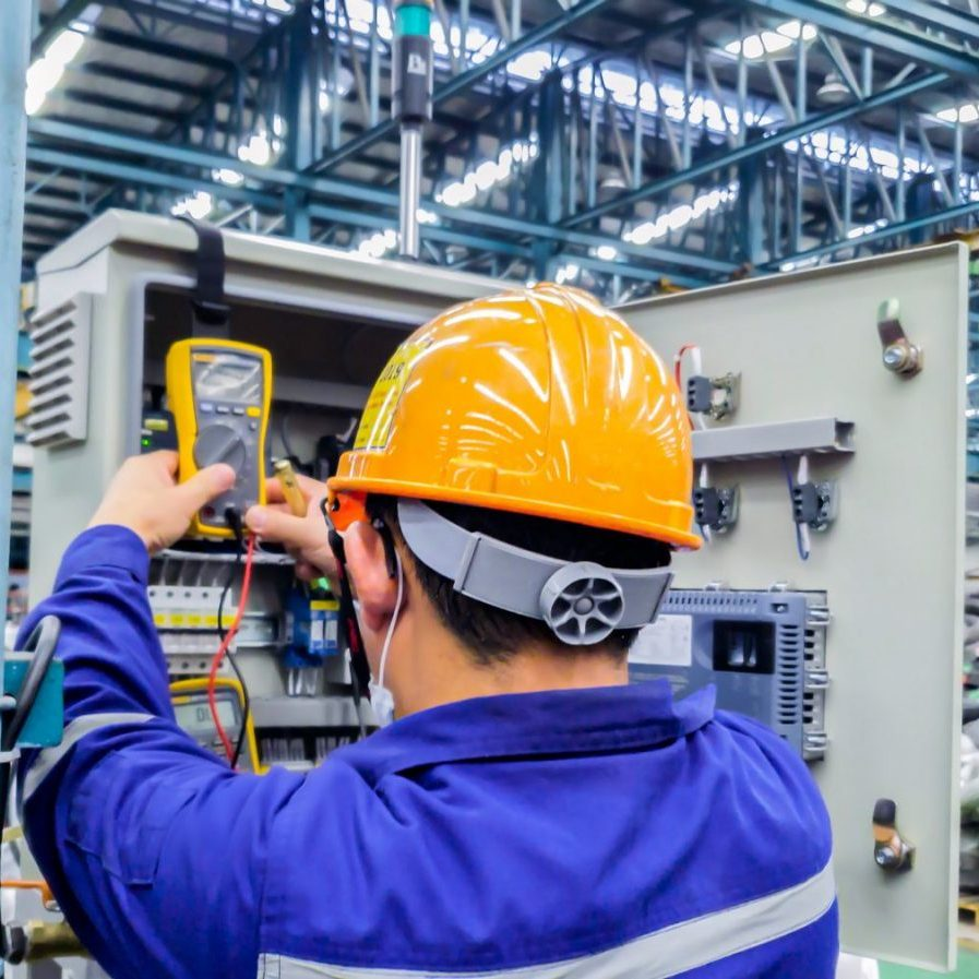 Blur,Background,Of,Electrical,Engineer,Are,Working,On,Factory,Site,