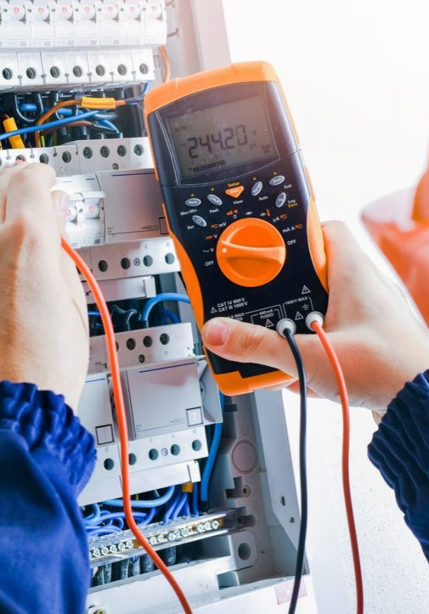 Electrician,Installing,Electric,Cable,Wires,And,Fuse,Switch,Box.,Multimeter